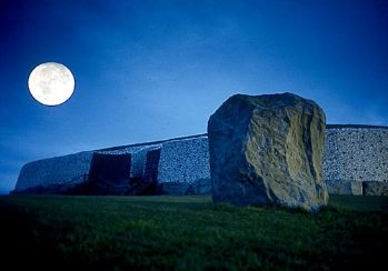 Moonlit Newgrange Burial Chamber and Standing Stone, County Meath, Ireland.Photographer: Tim Hannan